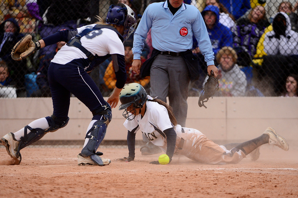 . Legacy\'s Shania Leon scores a run as Legend catcher Robyn Leighton gathers the loose ball during the Lightning\'s 6-4 state title win at the Aurora Sports Park on Sunday, October 20, 2013. The win was Legacy\'s sixth title in seven years. (Photo by AAron Ontiveroz/The Denver Post)