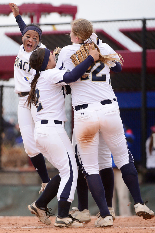 . Legacy players celebrate following the final out of the Lightning\'s 6-4 state title win over Legend at the Aurora Sports Park on Sunday, October 20, 2013. The win was Legacy\'s sixth title in seven years. (Photo by AAron Ontiveroz/The Denver Post)