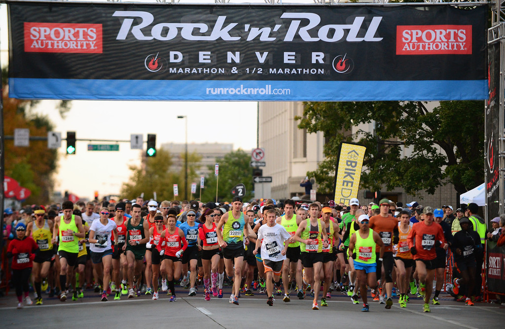 . Racers begin racing in the 4th annual Rock \'N\' Roll Marathon and 1/2 Marathon sponsored by Sports Authority in Denver, Co on October 20, 2013.  More than 15,000 participants and thousands of spectators, family and friends took part in the festivities that started and ended in Civic Center park. (Photo By Helen H. Richardson/ The Denver Post)