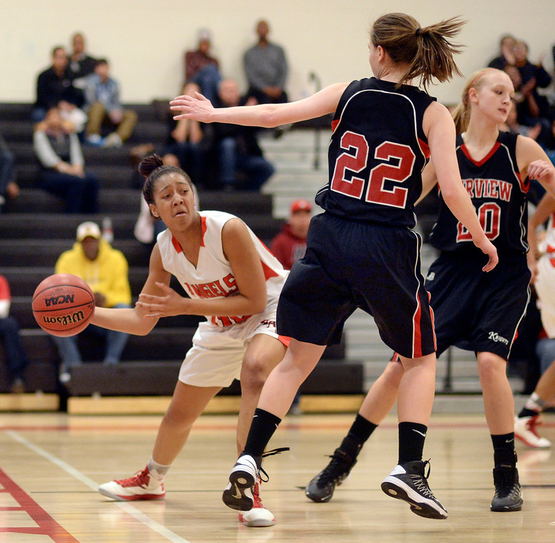 . East freshman Raeyanna Culbreath (50) passed the ball behind Fairview\'s Caroline Mckee (22). The Denver East High School girl\'s basketball team defeated Fairview 68-53 Friday night, February 28, 2014. Photo By Karl Gehring/The Denver Post