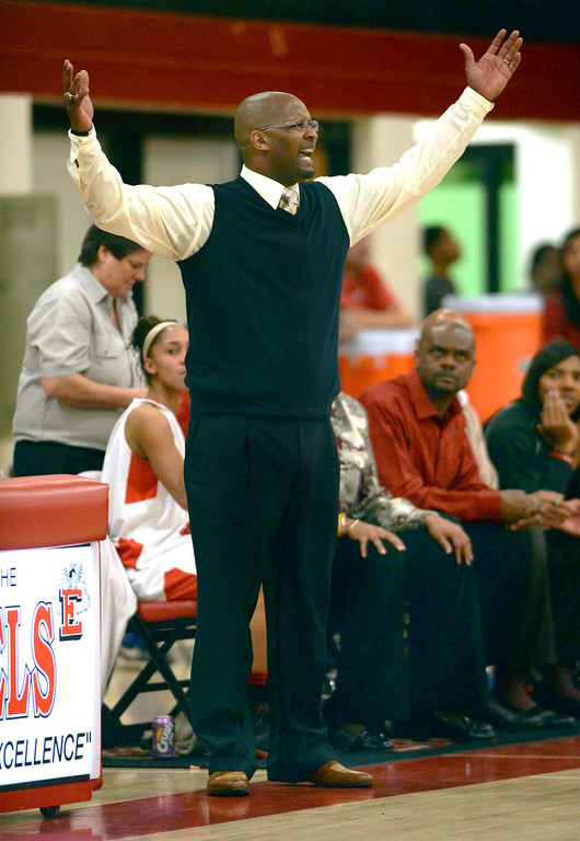 . Denver East coach Dwight Berry questioned a line violation whistle in the second half. The Denver East High School girl\'s basketball team defeated Fairview 68-53 Friday night, February 28, 2014. Photo By Karl Gehring/The Denver Post