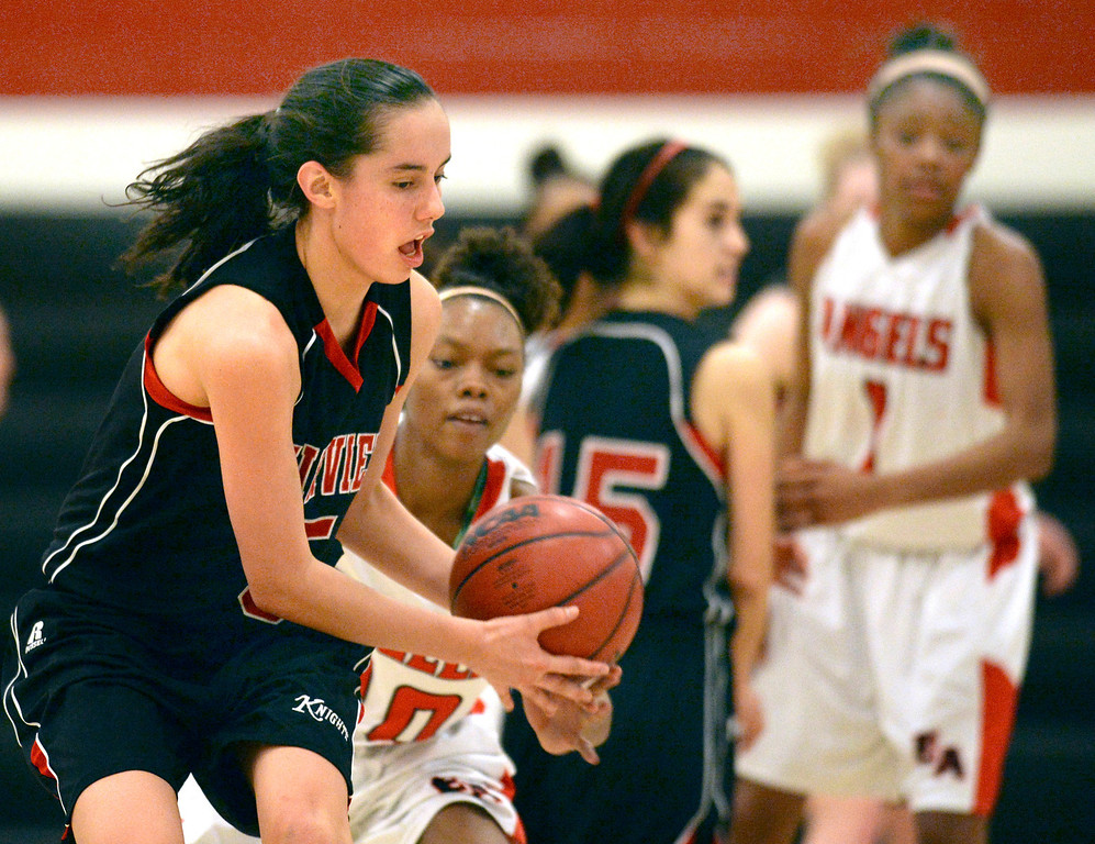 . Fairview junior Annika Lai (5) was pressured by East defender Damajahnee Birch (10) late in the fourth quarter. The Denver East High School girl\'s basketball team defeated Fairview 68-53 Friday night, February 28, 2014. Photo By Karl Gehring/The Denver Post