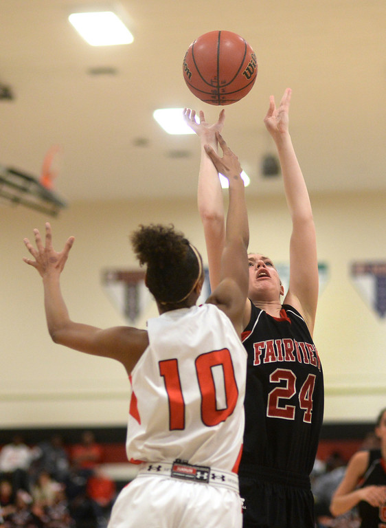 . Fairview center Sarah Kaufmann (24) tried to put up a shot over Denver junior Damajahnee Birch (10) in the second half. The Denver East High School girl\'s basketball team defeated Fairview 68-53 Friday night, February 28, 2014. Photo By Karl Gehring/The Denver Post