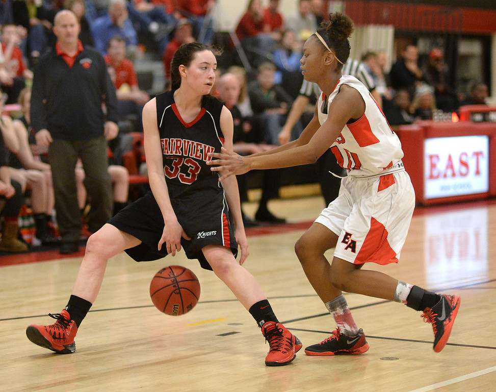 . East junior Damajahnee Birch (10) played defense on Fairview guard Sarah Kaufmann (33) in the second half. The Denver East High School girl\'s basketball team defeated Fairview 68-53 Friday night, February 28, 2014. Photo By Karl Gehring/The Denver Post