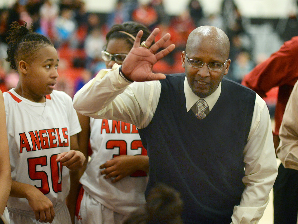 . East coach Dwight Berry urged the team to keep up the pressure in the fourth quarter. The Denver East High School girl\'s basketball team defeated Fairview 68-53 Friday night, February 28, 2014. Photo By Karl Gehring/The Denver Post