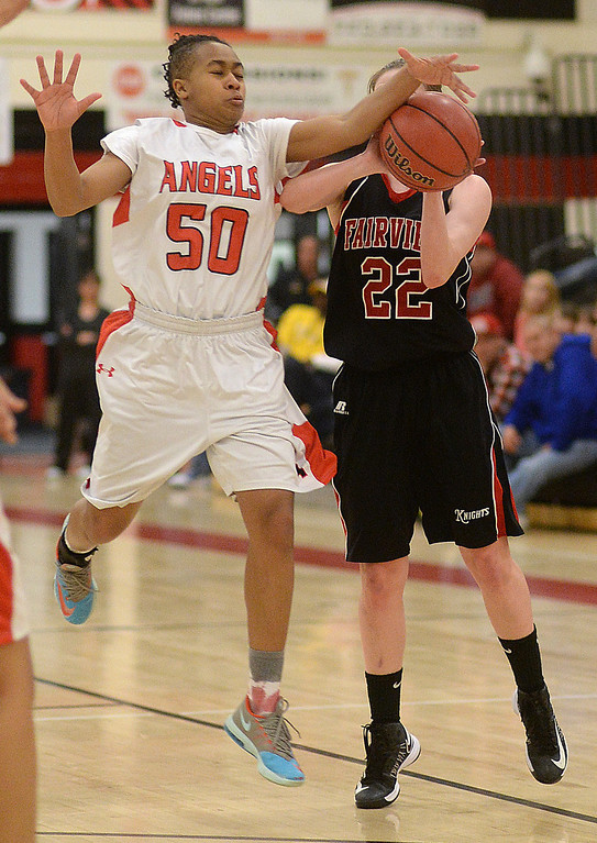 . Angels\' freshman Raeyanna Culbreath (50) blocked a shot by Fairview senior Caroline McKee (22) in the second half. The Denver East High School girl\'s basketball team defeated Fairview 68-53 Friday night, February 28, 2014. Photo By Karl Gehring/The Denver Post
