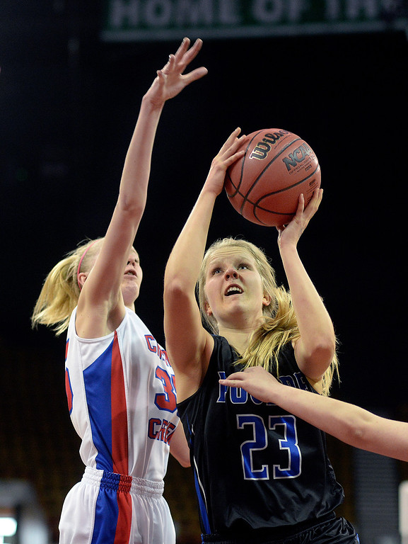 . Poudre senior guard McKenzie McDaniel (23) made a move past Cherry Creek defender Laura Pranger (35) in the first half. The Cherry Creek High School girl\'s basketball team met Poudre in a 5A playoff game Thursday night, March 5, 2014 at the Denver Coliseum. Photo By Karl Gehring/The Denver Post