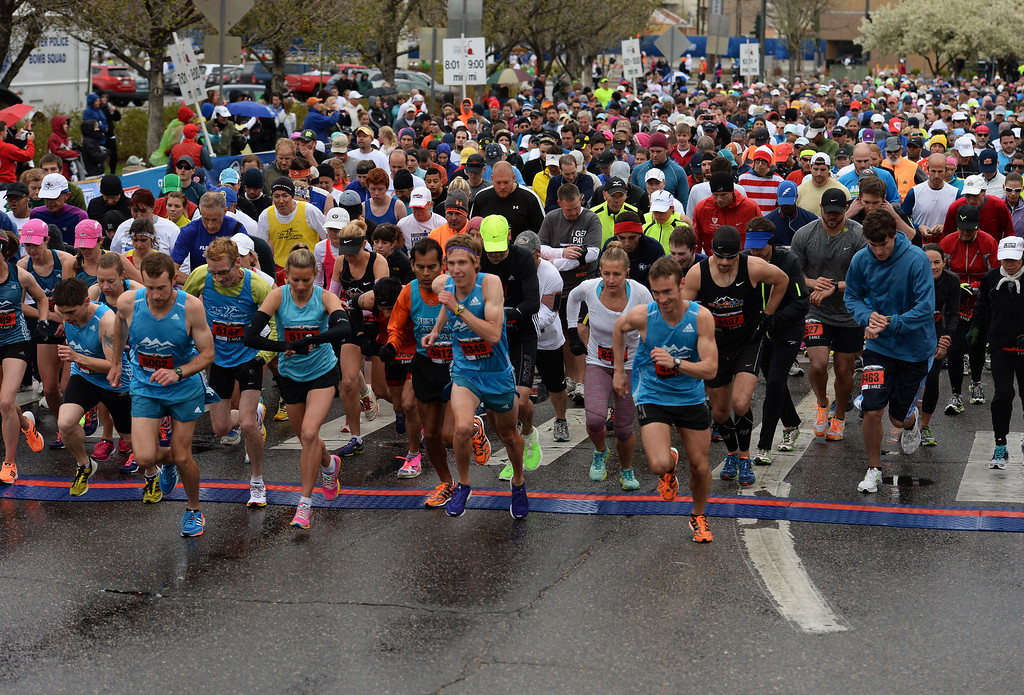 . Runners participating in the 32nd annual Cherry Creek Sneak in Denver sprint across the starting line of the 5-mile run of the 32nd annual Cherry Creek Sneak in Denver on April 27, 2014. (Photo By Helen H. Richardson/ The Denver Post)