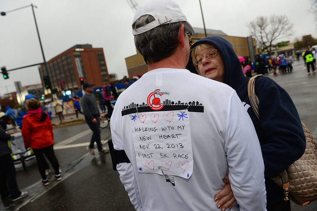 . Betty Schreiner, right, gives her husband Vernon a hug before he takes part in the 5k race.  Schreiner had a heart transplant in November of 2013 and this was his first race.   (Photo By Helen H. Richardson/ The Denver Post)