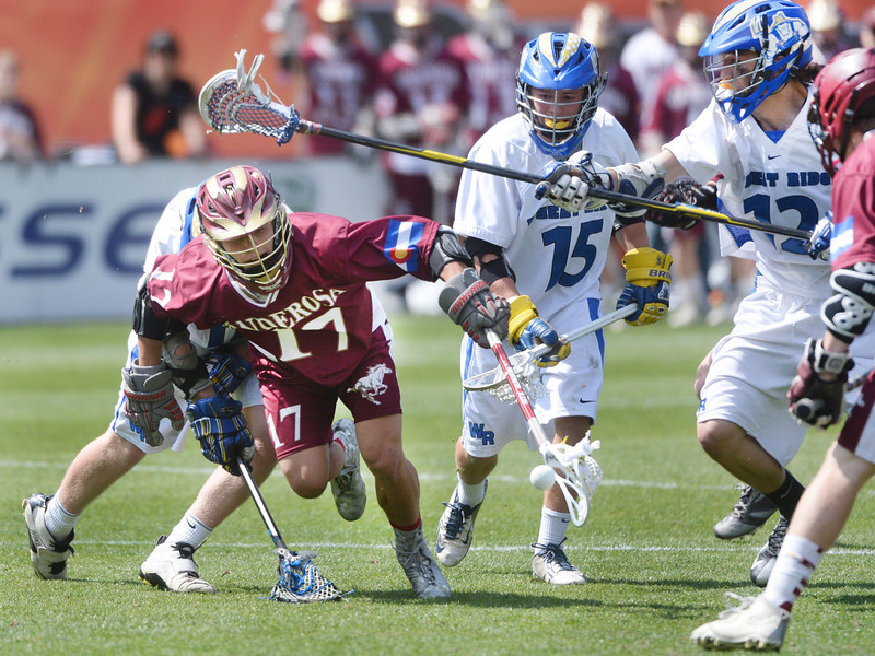 . Ponderosa midfielder Jack Griffin struggled to keep possession in front of the Farmer\'s net. Ponderosa High School boy\'s lacrosse team defeated Wheat Ridge 13-11 in the 4A championship game Saturday afternoon, May 17, 2014. (Photo by Karl Gehring/The Denver Post)