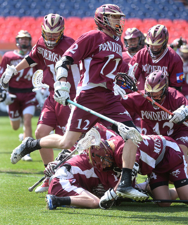 . Junior attack Derik Mango (12) celebrated at the final whistle. The Ponderosa High School boy\'s lacrosse team defeated Wheat Ridge 13-11 in the 4A championship game Saturday afternoon, May 17, 2014. (Photo by Karl Gehring/The Denver Post)