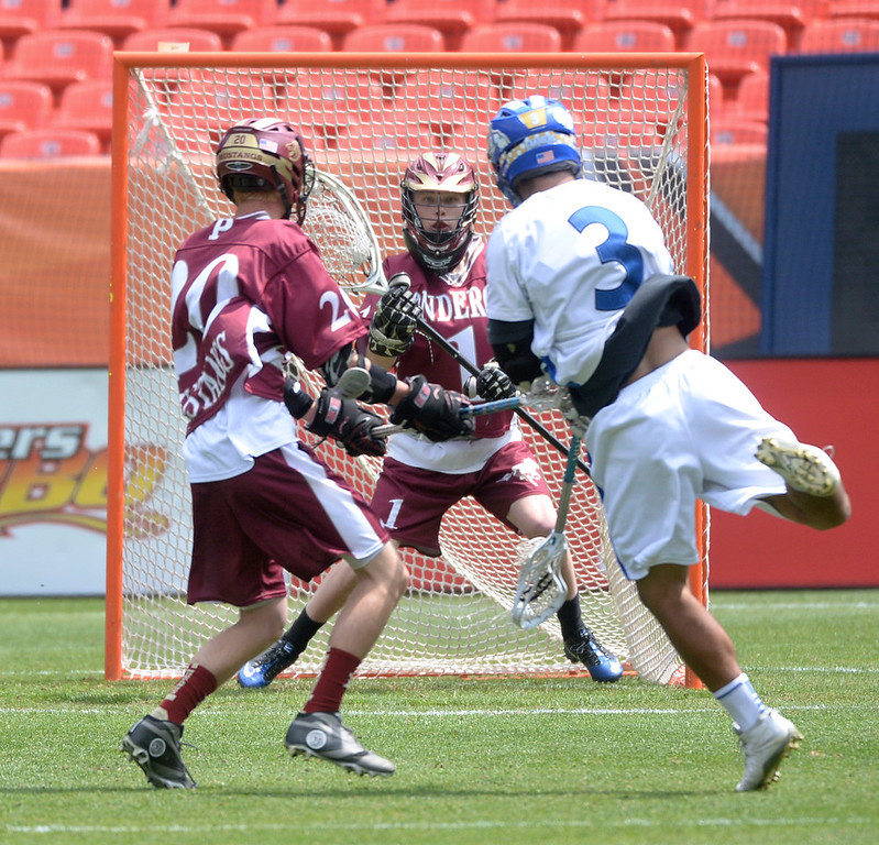. Wheat Ridge attack Max Marcum (3) directed a shot at Ponderosa goalie Jacob Ochs in the first half. Ponderosa High School boy\'s lacrosse team defeated Wheat Ridge 13-11 in the 4A championship game Saturday afternoon, May 17, 2014. (Photo by Karl Gehring/The Denver Post)