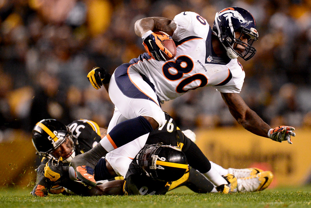 . PITTSBURGH, PA - DECEMBER 20: Vernon Davis (80) of the Denver Broncos is stopped by Lawrence Timmons (94) of the Pittsburgh Steelers and Ryan Shazier (50) during the second half of the Steelers\' 34-27 win at Heinz Field. The Pittsburgh Steelers hosted the Denver Broncos on Sunday, December 20, 2015. (Photo by AAron Ontiveroz/The Denver Post)
