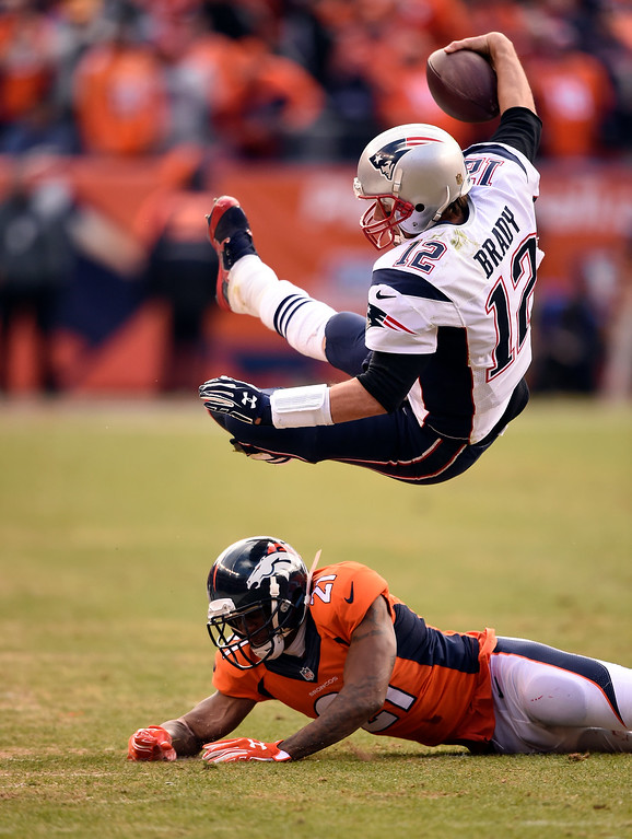 . DENVER, CO - JANUARY 24: Quarterback Tom Brady (12) of the New England Patriots runs for a first down and is taken down by cornerback Aqib Talib (21) of the Denver Broncos in the second quarter.  The Denver Broncos played the New England Patriots in the AFC championship game at Sports Authority Field at Mile High in Denver, CO on January 24, 2016. (Photo by John Leyba/The Denver Post)