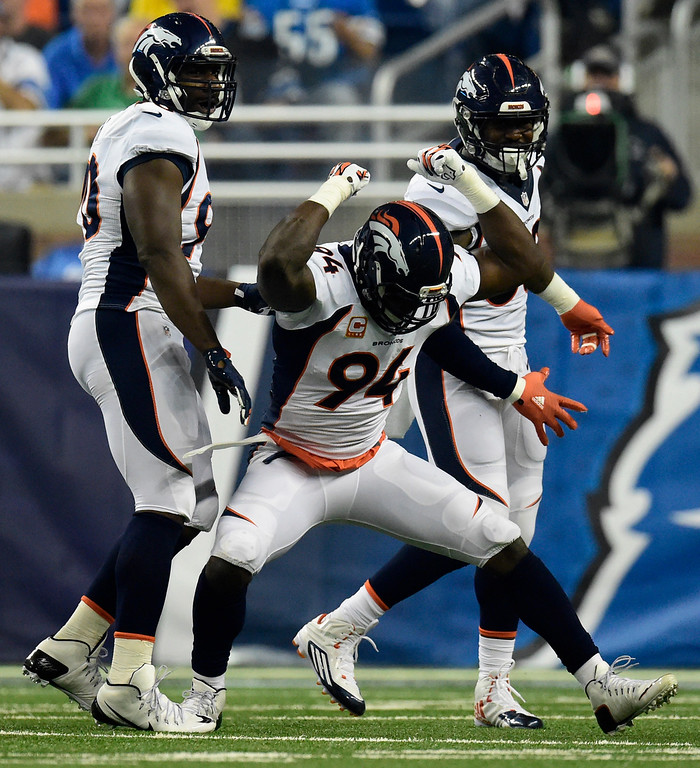 . DETROIT, MI - SEPTEMBER 27: DeMarcus Ware (94) of the Denver Broncos celebrates his sack on Matthew Stafford (9) of the Detroit Lions during the first half of play at Ford Field. The Detroit Lions hosted the Denver Broncos in NFL week 3 action on Sunday, September 27, 2015. (Photo by AAron Ontiveroz/The Denver Post)