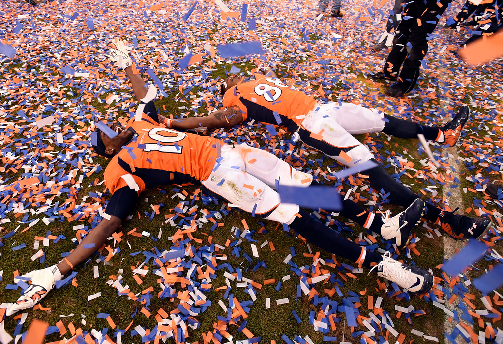 . DENVER, CO - JANUARY 24: Wide receiver Demaryius Thomas (88) of the Denver Broncos and wide receiver Emmanuel Sanders (10) of the Denver Broncos make angles in the confetti after the Broncos defeated the Patriots 20 to 18 winning the AFC championship.  The Denver Broncos played the New England Patriots in the AFC championship game at Sports Authority Field at Mile High in Denver, CO on January 24, 2016. (Photo by John Leyba/The Denver Post)