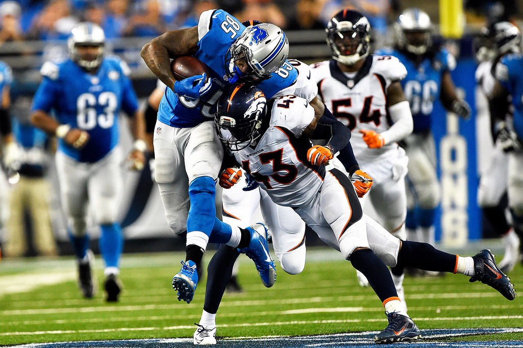 . DETROIT, MI - SEPTEMBER 27: Denver Broncos strong safety T.J. Ward #43 puts aa hit on Detroit Lions tight end Eric Ebron #85 after he makes a first down catch in the 4th quarter at Ford Field in Detroit, Mi, September 27, 2015 (Photo By Joe Amon/The Denver Post)