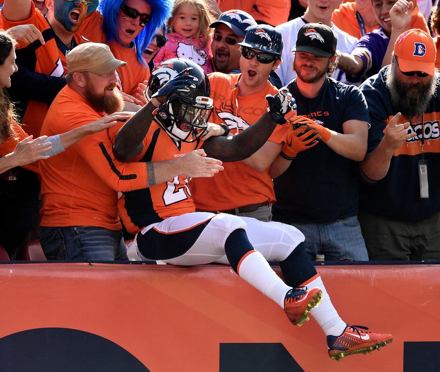 . Ronnie Hillman (23) of the Denver Broncos celebrates after scoring the Broncos first touchdown of the game in the second quarter.  The Denver Broncos played the Minnesota Vikings at Sports Authority Field at Mile High in Denver, CO on October 4, 2015. (Photo by Helen H. Richardson/The Denver Post)