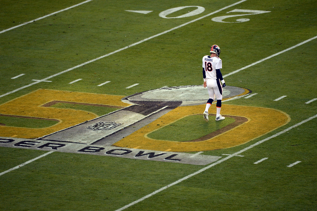 . SANTA CLARA, CA - FEBRUARY 7: Peyton Manning (18) of the Denver Broncos walks on the Super Bowl 50 logo during the first quarter.  The Denver Broncos played the Carolina Panthers in Super Bowl 50 at Levi\'s Stadium in Santa Clara, Calif. on February 7, 2016. (Photo by RJ Sangosti/The Denver Post)