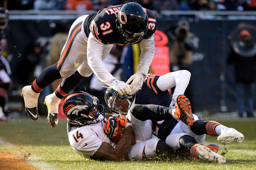 . Cody Latimer (14) of the Denver Broncos scores a touchdown to give the Broncos a 17-9 lead over the Chicago Bears as Chris Prosinski (31) and Kyle Fuller (23) defend during the second half of the Broncos\' 17-15 win at Soldier Field. The Chicago Bears hosted the Denver Broncos on Sunday, November 22, 2015. (Photo by AAron Ontiveroz/The Denver Post)