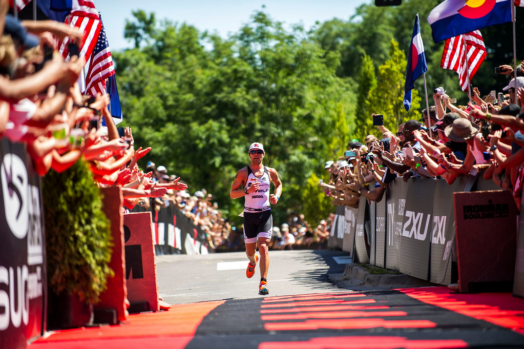 . Fans and well-wishers cheer as Justin Daerr, of Boulder, runs towards the finish line of the Boulder Ironman on Sunday, August 03, 2014 in Boulder, Colorado.  The first time a full race has been held in Boulder, the Ironman Triathlon features a 2.4 mile swim starting at the Boulder Reservoir followed by a 112 mile bike ride finished off with a 26.2 mile run along the Boulder Creek Trail.  (Photo by Kent Nishimura/The Denver Post)