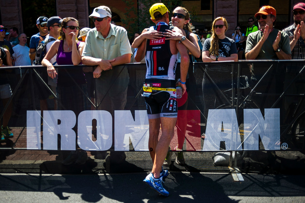 . Finishing second after leading for most of the race, Richie Cunningham and his wife Melissa Cunningham after crossing the finish line of the Boulder Ironman on Sunday, August 03, 2014 in Boulder, Colorado.  The first time a full race has been held in Boulder, the Ironman Triathlon features a 2.4 mile swim starting at the Boulder Reservoir followed by a 112 mile bike ride finished off with a 26.2 mile run along the Boulder Creek Trail.  (Photo by Kent Nishimura/The Denver Post)