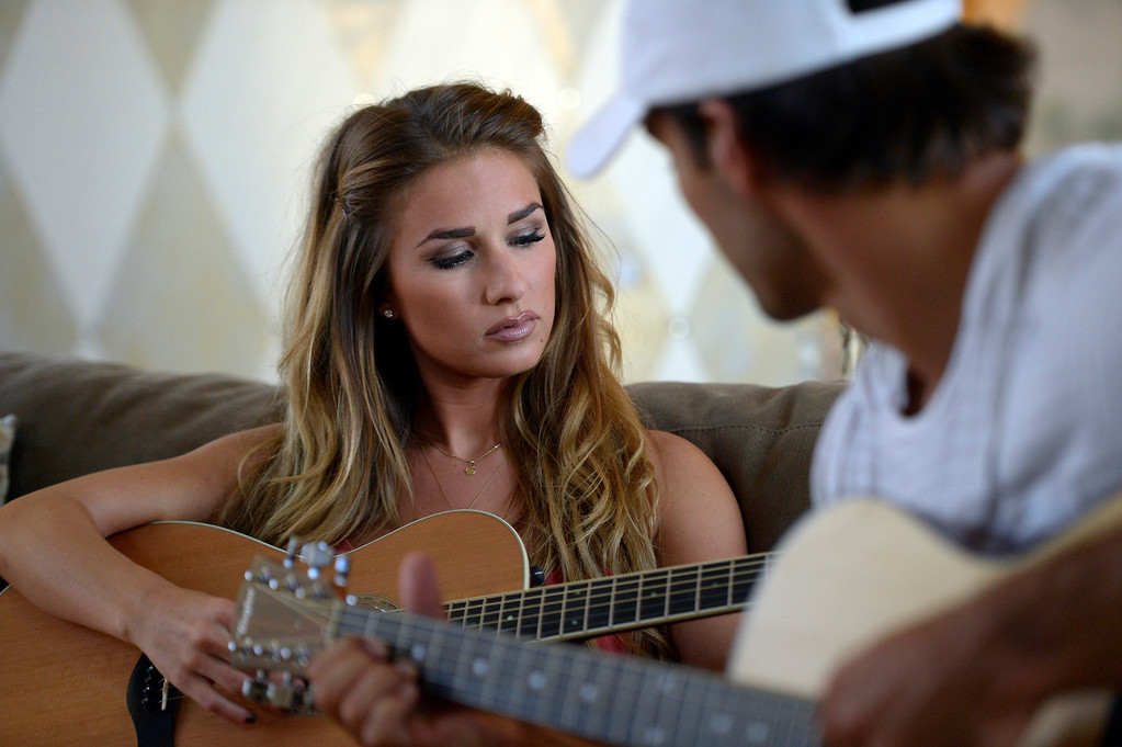 . CASTLE ROCK, CO. - JULY 17: Denver Broncos Eric Decker and his wife Jessie James play their guitars at their home July 17, 2013. Profile story on the wide receiver. (Photo By John Leyba/The Denver Post)