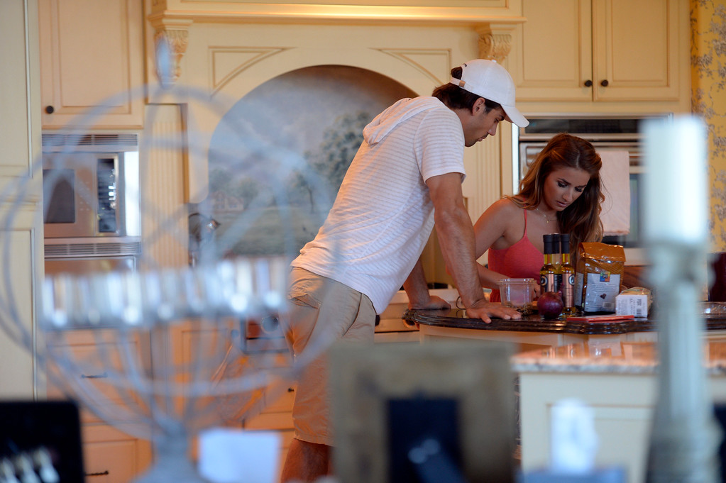 . CASTLE ROCK, CO. - JULY 17: Denver Broncos Eric Decker and his wife Jessie James prep for dinner at their home July 17, 2013. Profile story on the wide receiver. (Photo By John Leyba/The Denver Post)