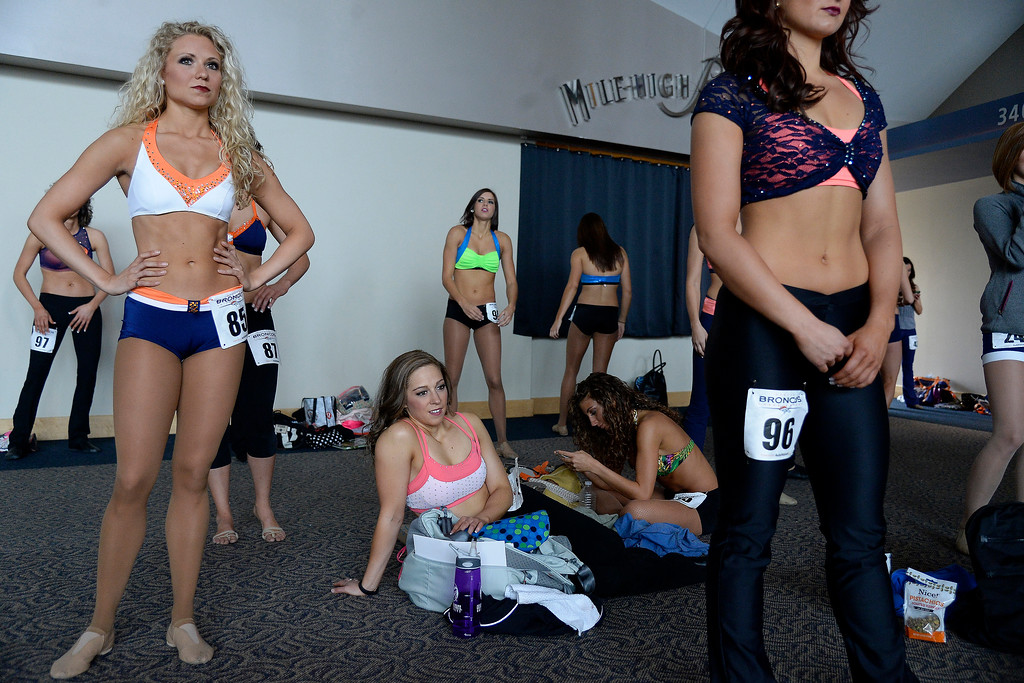 . Women prepare for their turns to dance during tryouts for the 2014-2015 Denver Broncos cheerleaders. More than 100 women showed up and 57 finalists were selected for the 26 spots on the team at Sports Authority Field at Mile High on Sunday, March 30. (Photo By AAron Ontiveroz/The Denver Post)