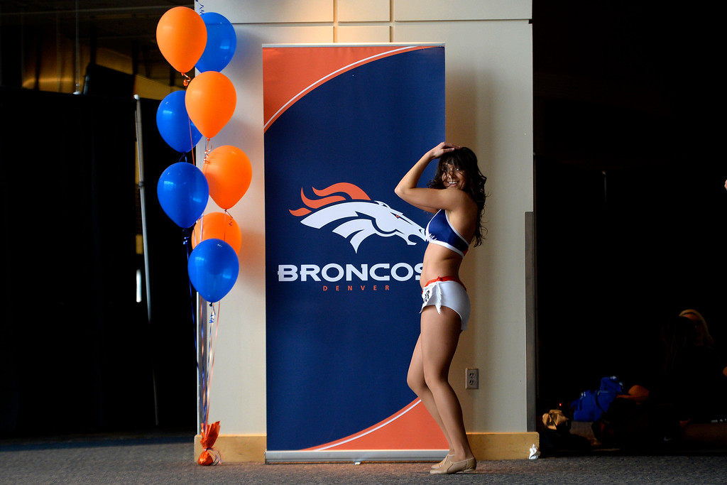 . A dancer warms up for her shot at a tryout during tryouts for the 2014-2015 Denver Broncos cheerleaders. More than 100 women showed up and 57 finalists were selected for the 26 spots on the team at Sports Authority Field at Mile High on Sunday, March 30. (Photo By AAron Ontiveroz/The Denver Post)