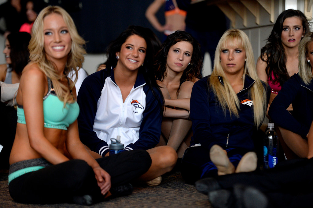 . Women watch as fellow competitors dance during tryouts for the 2014-2015 Denver Broncos cheerleaders. More than 100 women showed up and 57 finalists were selected for the 26 spots on the team at Sports Authority Field at Mile High on Sunday, March 30. (Photo By AAron Ontiveroz/The Denver Post)