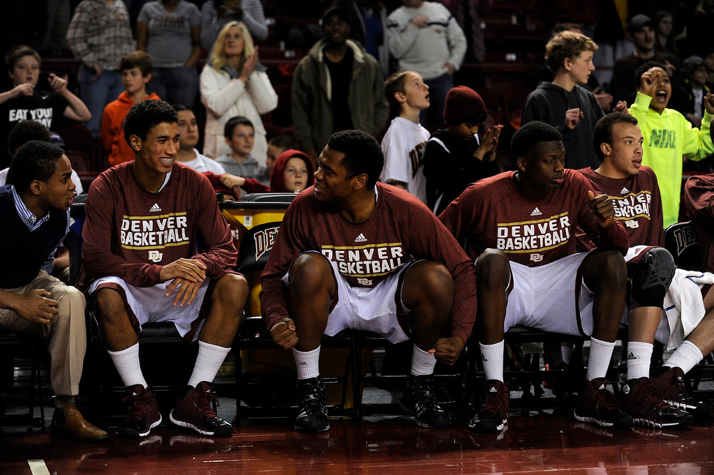 . The University of Denver bench celebrates after pulling off a close win against North Dakota at Magness Arena in Denver, Colorado on February 1, 2014. The Pioneers defeated the Bison 67-63. (Photo by Seth McConnell/The Denver Post)