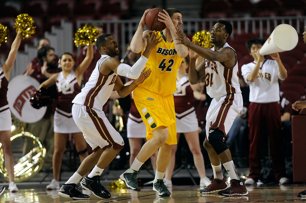 . North Dakota State forward Marshall Bjorklund (42) is pressured by University of Denver forward Chris Udofia (34) and Jalen Love (3) as he looks for an open teammate during the first half at Magness Arena in Denver, Colorado on February 1, 2014. (Photo by Seth McConnell/The Denver Post)