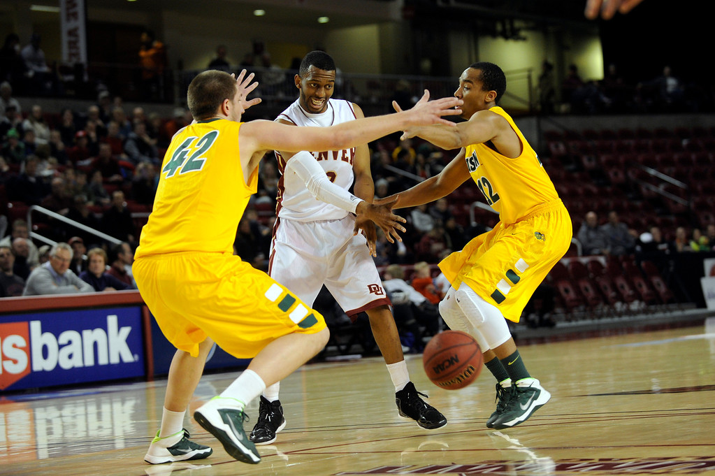 . University of Denver guard Jalen Love (3) dumps the ball to a teammate as he is double teamed during the first half at Magness Arena in Denver, Colorado on February 1, 2014. (Photo by Seth McConnell/The Denver Post)