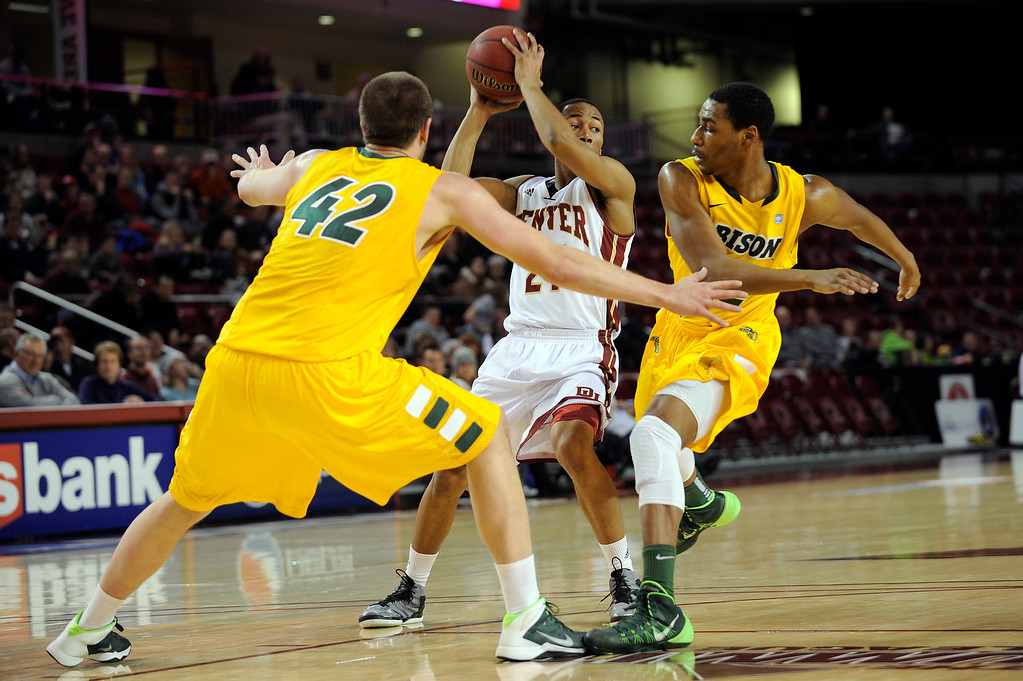 . University of Denver guard Bryant Rucker (21) looks for an open teammate as he is double teamed by North Dakota State during the first half at Magness Arena in Denver, Colorado on February 1, 2014. (Photo by Seth McConnell/The Denver Post)