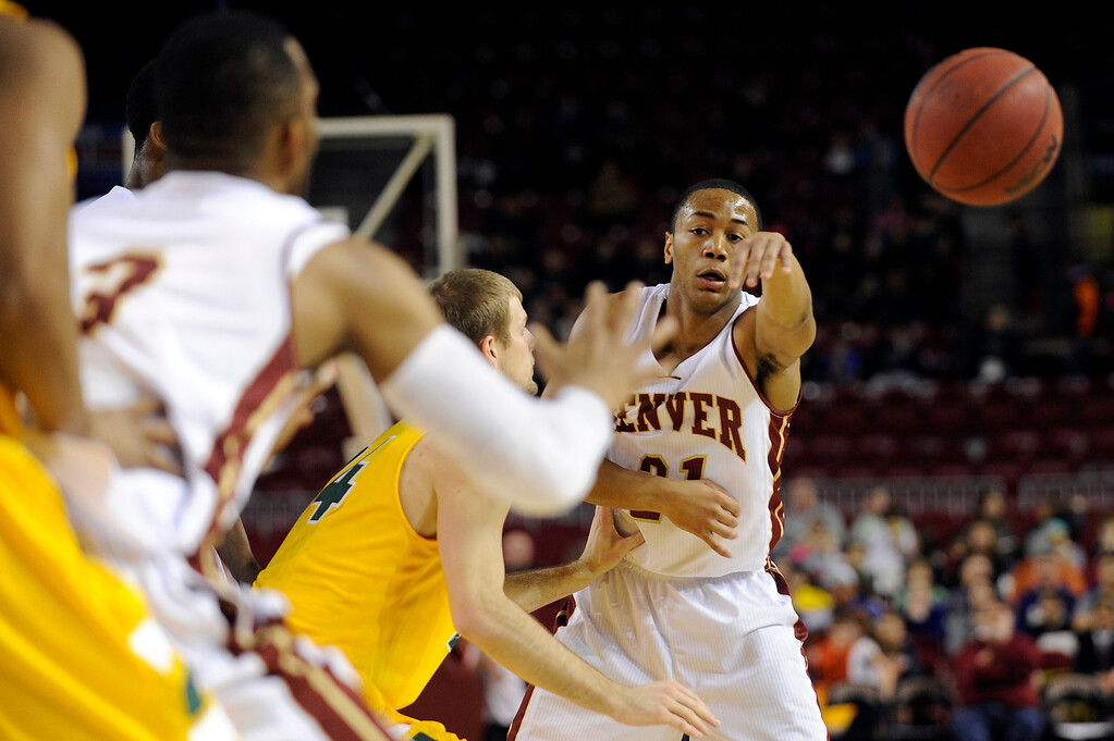. University of Denver guard Bryant Rucker (21) pass the ball to an open teammate during the first half at Magness Arena in Denver, Colorado on February 1, 2014. (Photo by Seth McConnell/The Denver Post)