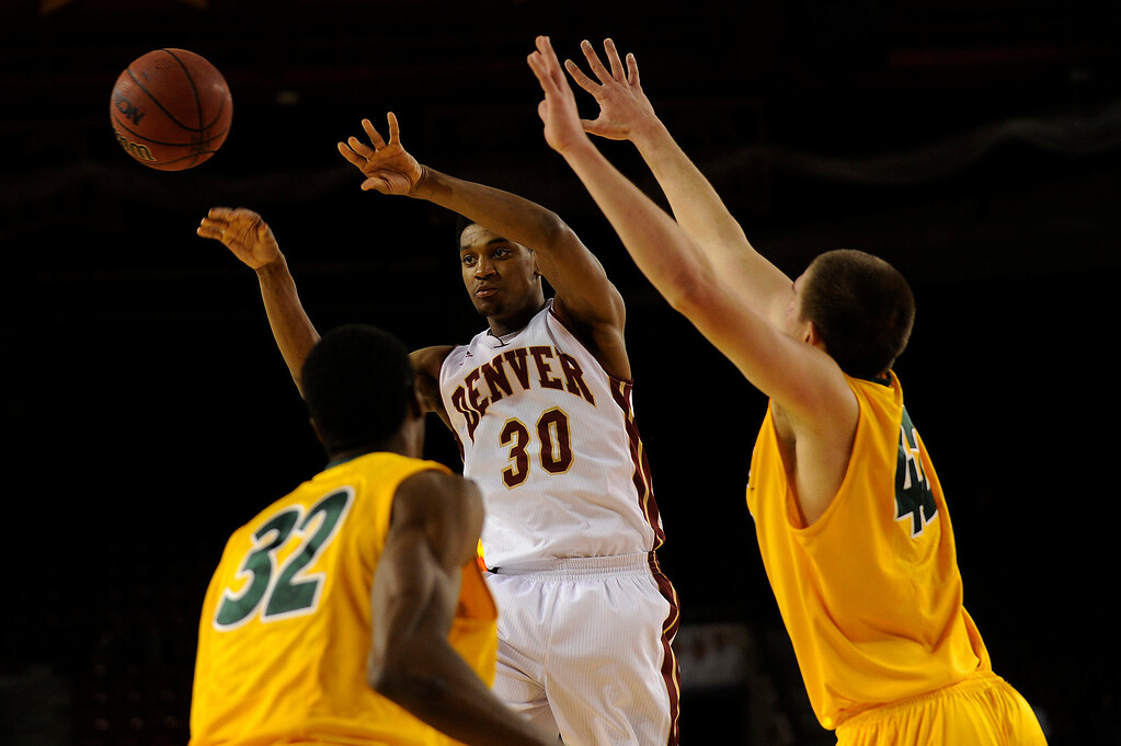 . University of Denver guard Cam Griffin (30) passes the ball to a teammate as he is double teamed by North Dakota State forward TrayVonn Wright (32) and North Marshall Bjorklund (42) during the second half at Magness Arena in Denver, Colorado on February 1, 2014. The Pioneers defeated the Bison 67-63. (Photo by Seth McConnell/The Denver Post)