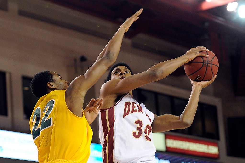 . University of Denver guard Cam Griffin (30) drives to the net as he is guarded by North Dakota State guard Kory Brown (22) during the first half at Magness Arena in Denver, Colorado on February 1, 2014. (Photo by Seth McConnell/The Denver Post)
