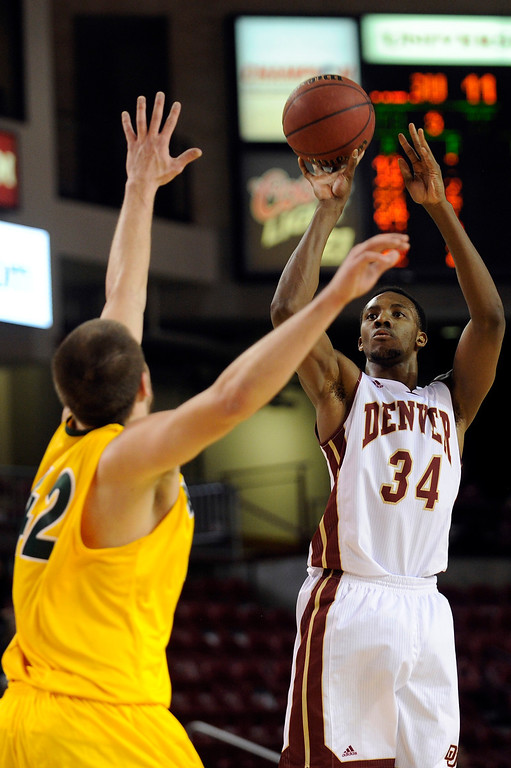 . University of Denver forward Chris Udofia (34) takes a shot on net during the first half at Magness Arena in Denver, Colorado on February 1, 2014. (Photo by Seth McConnell/The Denver Post)