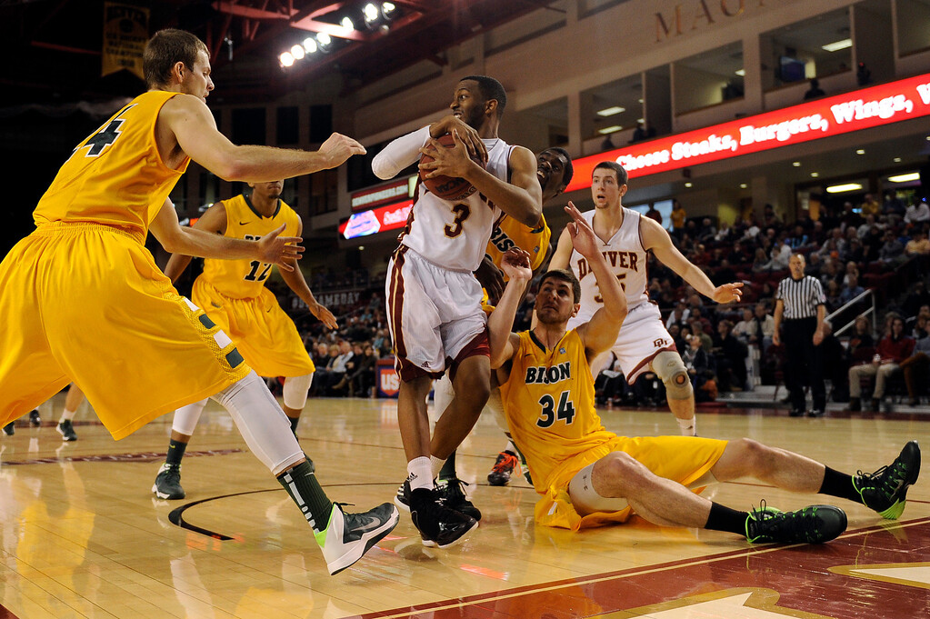. University of Denver guard Jalen Love (3) rips down a rebound as he is swarmed by North Dakota players during the second half at Magness Arena in Denver, Colorado on February 1, 2014. The Pioneers defeated the Bison 67-63. (Photo by Seth McConnell/The Denver Post)