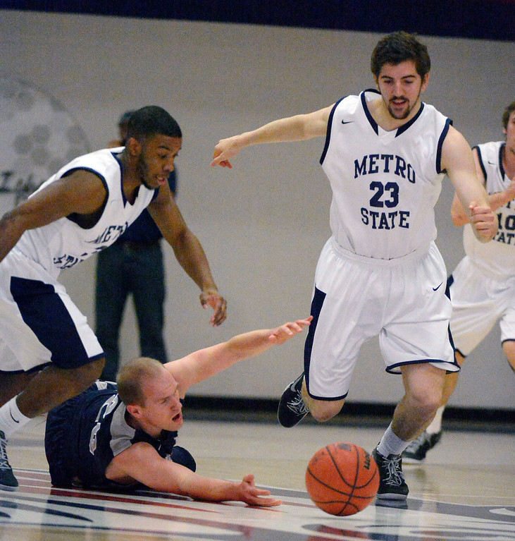 . Colorado Mines\' Trevor Ritchie (20) loses the ball as Metro State Brandon Jefferson (3) and Harrison Goodrick (23) look to pick it up during the first half of the Division ll Men\'s Basketball Championship March 16, 2014 at Auraria Event Center (Photo by John Leyba/The Denver Post)