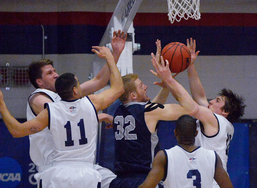 . Colorado Mines\' Trevor Wages (32) gets tangled up with Metro State\'s Raul Delgado (11) and Mitch McCarron (10) for a rebound during the first half of the Division ll Men\'s Basketball Championship March 16, 2014 at Auraria Event Center (Photo by John Leyba/The Denver Post)