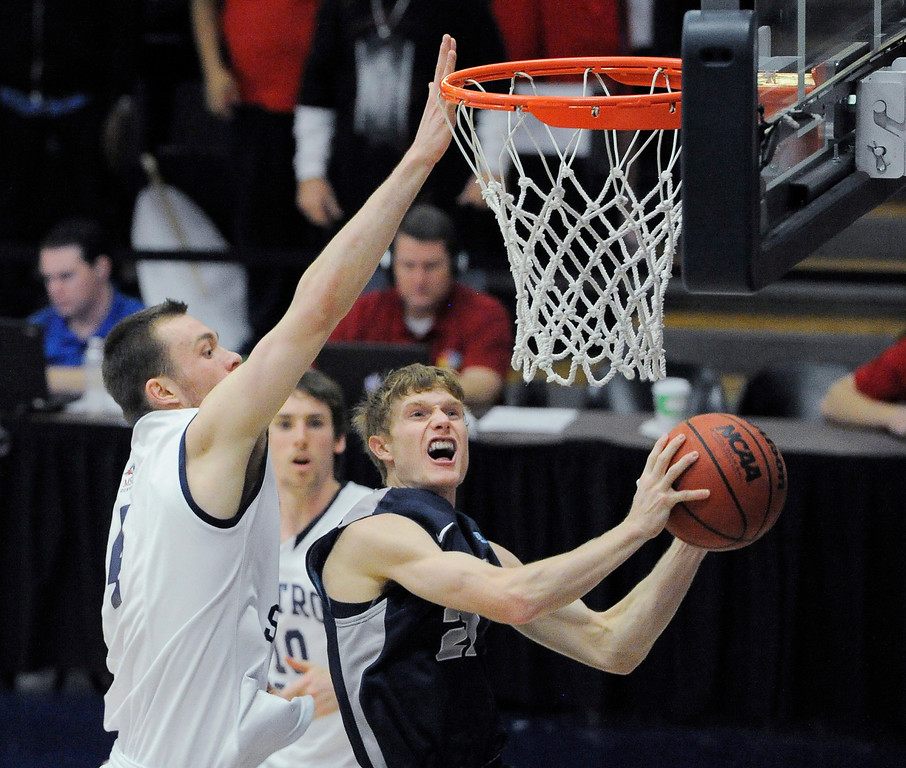 . Colorado Mines\' Brian Muller (22) goes up for a shot on Metro State\'s Nicholas Kay (4)  during the first half of the Division ll Men\'s Basketball Championship Tournament March 16, 2014 at Auraria Event Center (Photo by John Leyba/The Denver Post)
