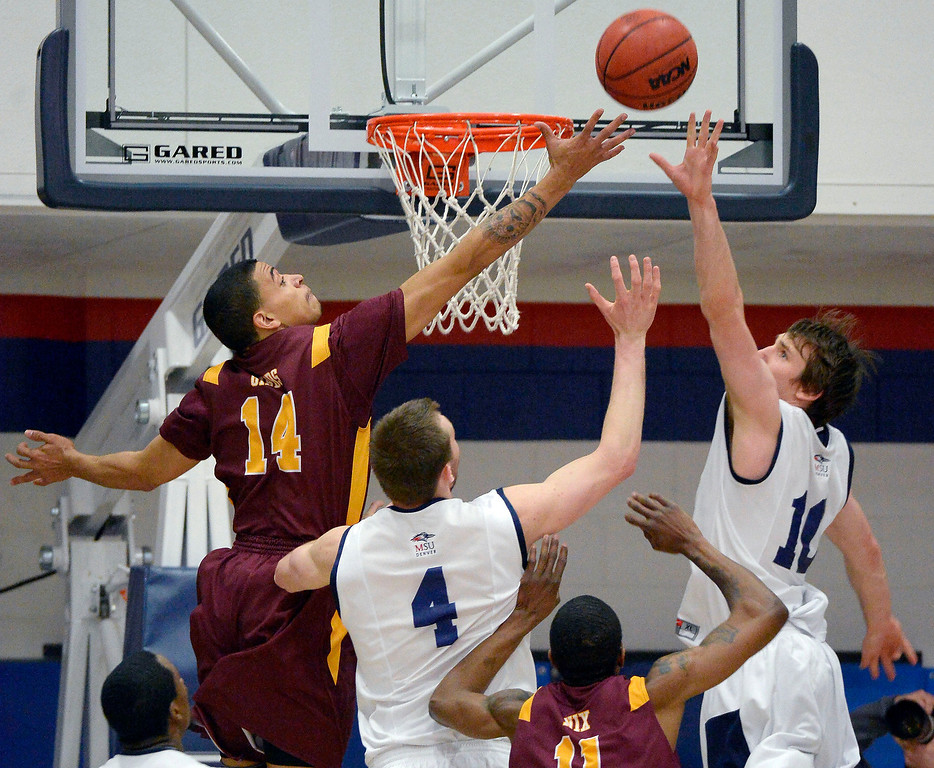 . Metro State Nicholas Kay (4) and Mitch McCarron (10) battle for a rebound with Midwestern State Derrell Gibbs (14) during the first half March 18, 2014 in the Championship game of the Division ll Men\'s Basketball Championship at Auraria Events Center. (Photo by John Leyba/The Denver Post)