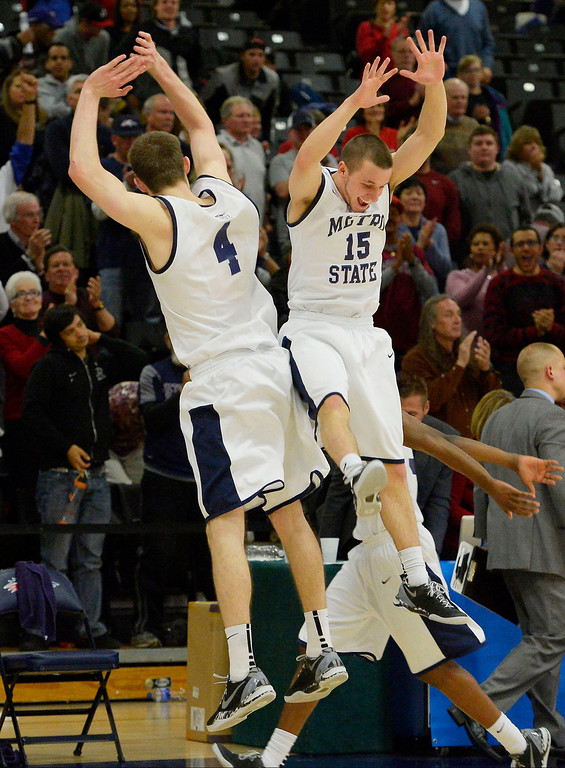 . Metro State Nicholas Kay (4) and Eric Rayer (15) celebrate their victory over Midwestern State 78-56 March 18, 2014 in the Championship game of the Division ll Men\'s Basketball Championship at Auraria Events Center. (Photo by John Leyba/The Denver Post)