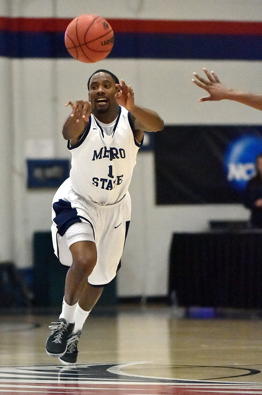 . Metro State Jamal McClerkin (1) throws an outlet pass against Midwestern State during the second half March 18, 2014 in the Championship game of the Division ll Men\'s Basketball Championship at Auraria Events Center. (Photo by John Leyba/The Denver Post)