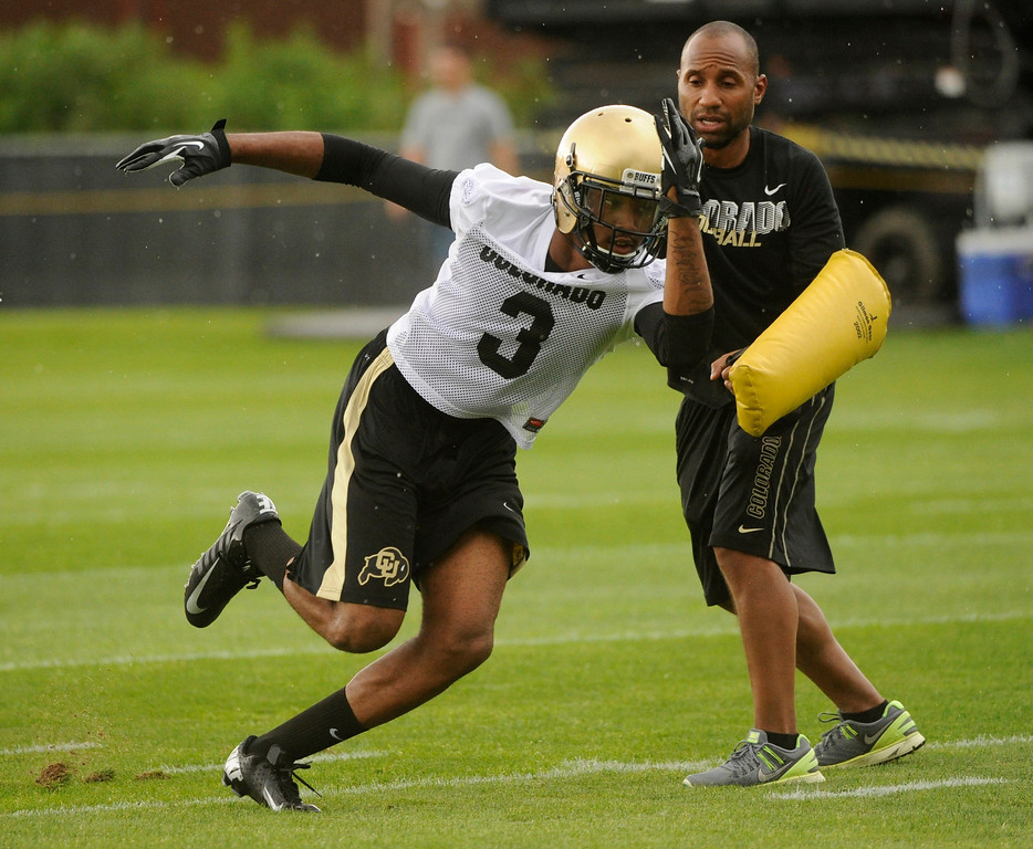 . BOULDER, CO. - AUGUST 06: Wide receiver Byrce Bobo (3) worked with coach Troy Walters at the beginning of practice Tuesday. The University of Colorado football team practiced for the first time Tuesday afternoon, August 6, 2013. Photo By Karl Gehring/The Denver Post