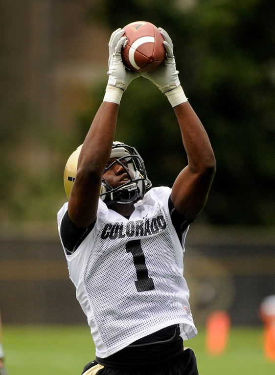 . BOULDER, CO. - AUGUST 06: Wide receiver Elijah Dunston (1) hauled in a pass during drills Tuesday. The University of Colorado football team practiced for the first time Tuesday afternoon, August 6, 2013. Photo By Karl Gehring/The Denver Post