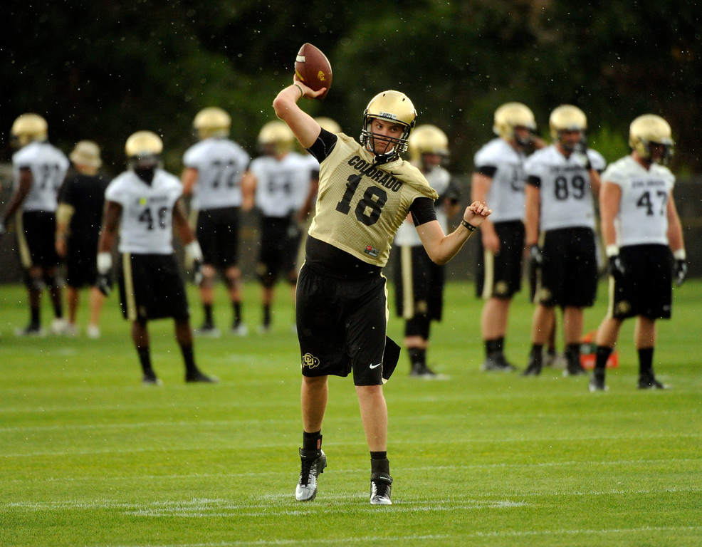 . BOULDER, CO. - AUGUST 06: Quarterback Stevie Joe Dorman warmed up before the lightning delay interrupted practice Tuesday. The University of Colorado football team practiced for the first time Tuesday afternoon, August 6, 2013. Photo By Karl Gehring/The Denver Post