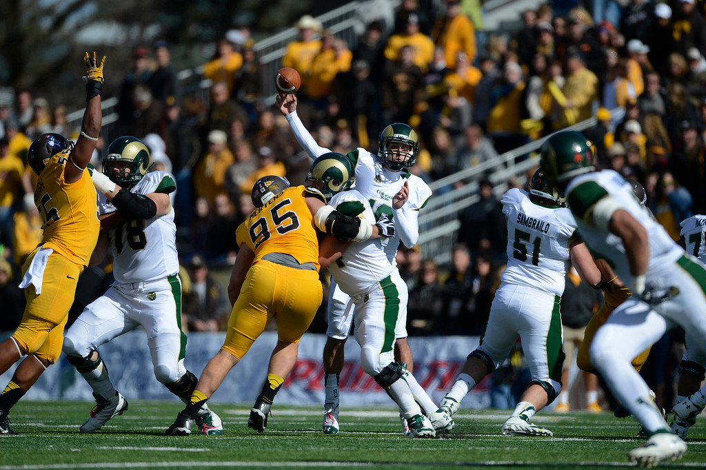 . Colorado State University QB, Garrett Grayson, passes against the Wyoming Cowboys in the first quarter of the game at Jonah Field at War Memorial Stadium Saturday, October 19, 2013.  (Photo By Andy Cross/The Denver Post)